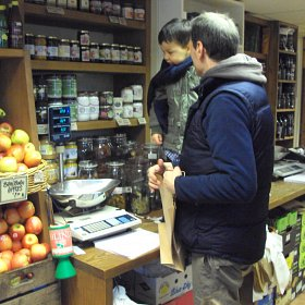 Children shopping in the local green grocer's: selecting and weighing